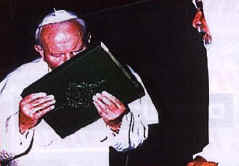 The Pope kisses the Koran in Iraq