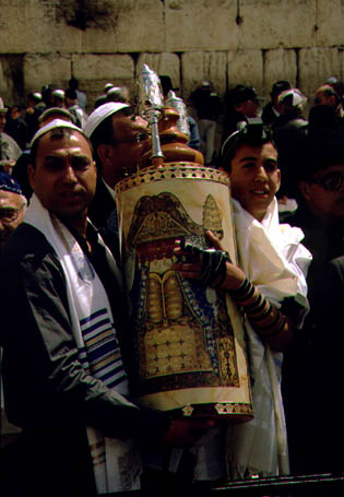 Carrying the Torah scroll   (c)