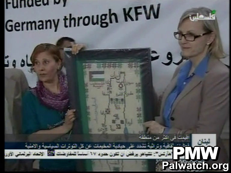 UNRWA representative poses with map that presents all of Israel as