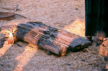 underside of threshing sled  -  showing iron teeth